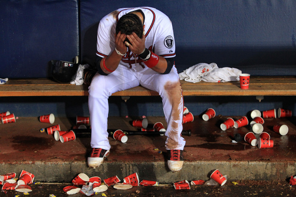 The Atlanta Braves' Martin Prado sits dejected in the dugout after falling out of playoff contention with a 4-3 loss to the Phillies in 13 innings on the final day of the regular season at Turner Field in Atlanta, Georgia on Wednesday, September 28, 2011. (Curtis Compton/Atlanta Journal-Constitution/MCT)
