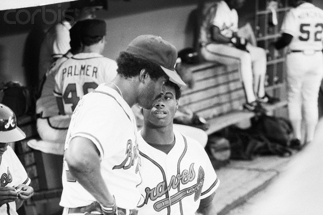02 Jun 1987, Atlanta, Georgia, USA --- 6/2/1987-Atlanta, GA- Ken Griffey, Jr., (r), the nation's number one draft pick, who is headed to the Seattle Mariners, has a dugout chat wth his dad, Ken Griffey, Sr., the Braves starting left fielder 6/2. --- Image by © Bettmann/CORBIS