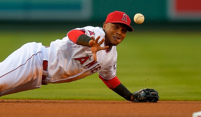 Los Angeles Angels shortstop Erick Aybar tosses the ball to second to force out Houston Astros' Jose Altuve after diving for a ball hit by George Springer during the first inning of a baseball game, Saturday, July 5, 2014, in, Anaheim, Calif.  (AP Photo/Mark J. Terrill)   ** Usable by LA, DC, CGC and CCT Only **