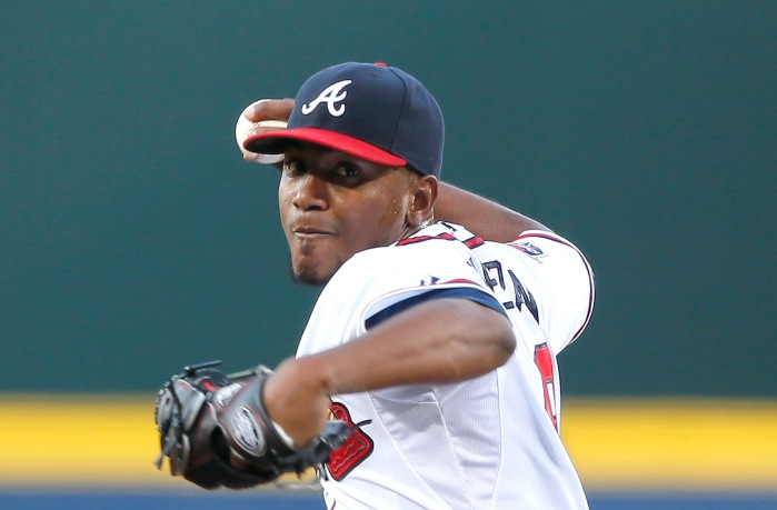 ATLANTA, GA - APRIL 21:  Julio Teheran #49 of the Atlanta Braves pitches in the first inning to the Miami Marlins at Turner Field on April 21, 2014 in Atlanta, Georgia.  (Photo by Kevin C. Cox/Getty Images)