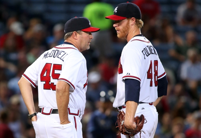 May 19, 2015; Atlanta, GA, USA; Atlanta Braves pitching coach Roger McDowell (45) talks with starting pitcher Mike Foltynewicz (48) in the fifth inning of their game against the Tampa Bay Rays at Turner Field. The Rays won 5-3. Mandatory Credit: Jason Getz-USA TODAY Sports